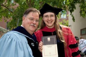 Myself with my advisor James Hankins and our co-authored book, at my Harvard Ph.D. graduation.