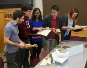 Undergraduates in my European Civilization course doing a hands-on session with antique books from the 14th through 18th Centuries
